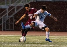 Naugatuck's Matheus Santis #32 and Newtown's Owen Baillargeon #10 battle for the ball during the first round of the CIAC Class LL boys' soccer tournament between #22 Newtown and #11 Naugatuck at Naugatuck High School in Naugatuck on Tuesday. Naugatuck beat Newtown 1-0 and advances to the next round on Thursday. Bill Shettle Republican-American