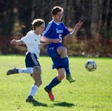 Nonnewaug's James Wolf (5) and Haddam-Killingsworth's John Kowal (17) battle for the ball during their Class M tournament game Wednesday at Nonnewaug High School in Woodbury. Jim Shannon Republican American