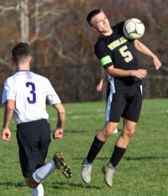 #5 Maciej Lewicki of Woodland controls the ball in front of #3 Kyle Bechard of Aerospace during CIAC Class M soccer action in Beacon Falls Wednesday. Steven Valenti Republican-American