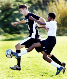 #14 Nick Hudson of Woodland and #4 Zyaan Haldane of Aerospace battle for the ball during CIAC Class M soccer action in Beacon Falls Wednesday. Steven Valenti Republican-American