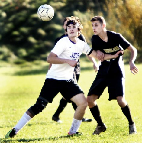#15 Josh Misunas of Aerospace and #14 Nick Hudson of Woodland battle for the ball during CIAC Class M soccer action in Beacon Falls Wednesday. Steven Valenti Republican-American
