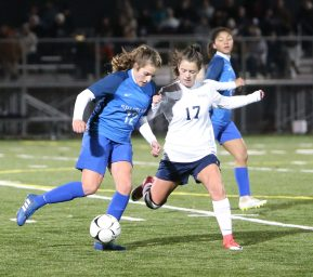 Lewis Mills High School's Victoria Fleming and Morgan High School's Alyssa Smith battle for the ball during the CIAC Class M semifinal girls varsity soccer tournament game on Falcon Field in Meriden on Monday. Emily J. Reynolds. Republican-American