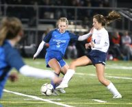 Lewis Mills High School's Grace Buchanan and Morgan High School's Kylee Clifton battle for the ball during the CIAC Class M semifinal girls varsity soccer tournament game on Falcon Field in Meriden on Monday. Emily J. Reynolds. Republican-American