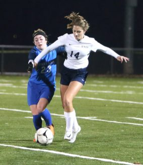 Lewis Mills High School's Abby Mills and Morgan High School's Kylee Clifton battle for the ball during the CIAC Class M semifinal girls varsity soccer tournament game on Falcon Field in Meriden on Monday. Emily J. Reynolds. Republican-American