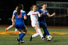 Watertown's Madison Mancini #7 splits the defense of Tolland's Olivia Cayward #18 and Tolland's Liz Deloreto #15 during the Girls Soccer Class L Semifinal game between Watertown and Tolland at Veterans Memorial Stadium at Willowbrook Park in New Britain on Monday. Tolland beat Watertown 2-1 and advances to the Class L finals. Bill Shettle Republican-American