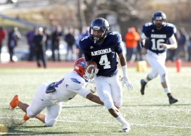 Ansonia's Tajik Bagley (4) carries the ball as Bloomfield's Ventine Richardson (34) misses the tackle during their Class S state final matchup in New Britain on Saturday. Ansonia would go onto lose, 31-20. Christopher Massa Republican-American