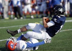 Bloomfield's Chris Rose (22) brings down Ansonia's Bryson Cafaro during their Class S state final matchup in New Britain on Saturday. Ansonia would go onto lose, 31-20. Christopher Massa Republican-American