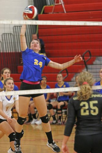 Seymour's Faith Rousseau #24 returns the ball against Woodland in Class M semi-final Volleyball tournament at Pomperaug High School Tuesday night. Seymour won 3-0. Michael Kabelka / Republican-American.