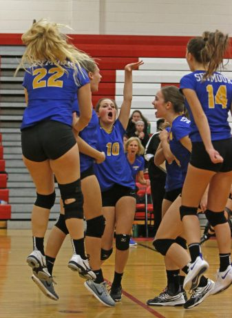 Seymour celebrates after scoring a point against Woodland in Class M semi-final Volleyball tournament at Pomperaug High School Tuesday night. Seymour won 3-0. Michael Kabelka / Republican-American.