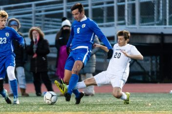 Pomperaug's Matthew Karp #20 sneaks in from behind knocking the ball away from Glastonbury's Devin Wasilefsky #8 during a Boys Soccer Class L Semifinal game between Glastonbury and Pomperaug at Veterans Memorial Stadium at Willowbrook Park in New Britain on Wednesday. Bill Shettle Republican-American