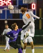 Watertown's Troy Tedesco #9 goes up to head the ball above Ellington's Jackson Kupferschmid #10 defending during a Boys Soccer Class M Semifinal game between Ellington and Watertown at Municipal Stadium in Waterbury on Wednesday. Bill Shettle Republican-American