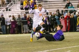 Watertown's Jake Champagne #18 runs over Ellington's Jackson Kupferschmid #10 gaining control of the ball during a Boys Soccer Class M Semifinal game between Ellington and Watertown at Municipal Stadium in Waterbury on Wednesday. Bill Shettle Republican-American