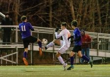 Watertown's Keith Caouette #14 and Ellington's Nicholas DeBaise #11 both get to the ball at the same time trying to control the ball during the Boys Soccer Class M Semifinal game between Ellington and Watertown at Municipal Stadium in Waterbury on Wednesday. Bill Shettle Republican-American