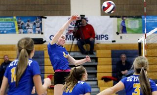 #24 Faith Rousseau of Seymour High send a ball over the net against Weston during the CIAC Class M volleyball championship game in East Haven Saturday. Steven Valenti Republican-American