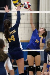 #11 Mackenzie Sirowich of Seymour puts a shot over the net as #14 Katherine Anderson defends of Weston during the CIAC Class M volleyball championship game in East Haven Saturday. Steven Valenti Republican-American