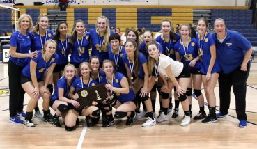Seymour High with the Championship trophy after beating Weston to win the CIAC Class M volleyball championship in East Haven Saturday. Steven Valenti Republican-American