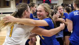 #1 Katherine Kucsera and #3 Alyssa Cosciello of Seymour hug after beating Weston to win the CIAC Class M volleyball championship in East Haven Saturday. Steven Valenti Republican-American