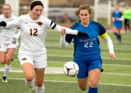 Plainfield's Alexis Price (12) and Lewis Mills' Grace Kryzanski (22) fight for possession during their Class M soccer championship game Sunday at West Haven High School. Jim Shannon Republican American