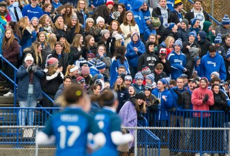 Lewis Mills fans and student body celebrate Grace Buchanan overtime goal during their Class M soccer championship game against Plainfield Sunday at West Haven High School. Buchanan's goal would be the game winner in their 2-1 overtime win. Jim Shannon Republican American
