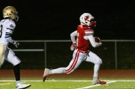 Pomperaug's Jacob Oldham #6 runs away from Notre Dame of Fairfield's Jadin Blackwell #13, for a touchdown during the regular season finale between Notre Dame of Fairfield and Pomperaug at Pomperaug High School in Southbury on Wednesday. Bill Shettle Republican-American