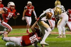 Pomperaug's Aidan Henry #80 sacks Notre Dame of Fairfield quarterback John Fasset #1 behind the line of scrimmage for a bit loss during the regular season finale between Notre Dame of Fairfield and Pomperaug at Pomperaug High School in Southbury on Wednesday. Bill Shettle Republican-American