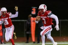 Pomperaug quarterback runs the ball on a keeper on his way for a touchdown during the regular season finale between Notre Dame of Fairfield and Pomperaug at Pomperaug High School in Southbury on Wednesday. Bill Shettle Republican-American