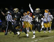 Woodland High School's Mike Farina and Zack Cochran celebrate an interception during the game at Woodland High School against Seymour High School on Wednesday. Emily J. Reynolds. Republican-American