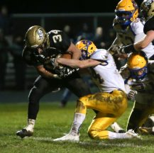 Woodland High School's Edit Krivca tries to evade a tackle by Seymour High School's Jacob Carfo during the game at Woodland High School on Wednesday. Emily J. Reynolds. Republican-American