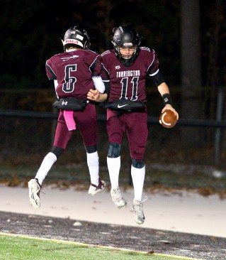 Torrington's Ora Curry (11) celebrates his 18-yard touchdown run with teammate Isaiah Hammonds (6) during their annual game against Watertown Wednesday at Torrington High School. Jim Shannon Republican American