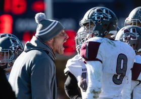 Naugatuck's Head coach Dave Sollazzo yells out at his defense during a NVL clash of unbeatens and the annual Thanksgiving Day game between Naugatuck and Ansonia at Jarvis Stadium at the Nolan Field Athletic Complex in Ansonia on Thursday. Bill Shettle Republican-American