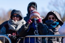 Ansonia graduates and Naugatuck residents Deanna Balksom, and Carol Anglace, along with Pamela Nobel of Waterbury look on all bundled up from the cold from the sidelines during a NVL clash of unbeatens and the annual Thanksgiving Day game between Naugatuck and Ansonia at Jarvis Stadium at the Nolan Field Athletic Complex in Ansonia on Thursday. Bill Shettle Republican-American