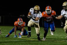 Woodland running back Edit Krivca #34 runs with ball past Bloomfield's Kyle Barrow #66 during the CIAC State Championships Class S Quarterfinal game between Woodland and Bloomfield at Bloomfield High School in Bloomfield on Tuesday. Bill Shettle Republican-American