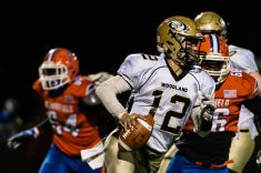 Woodland quarterback Tyler Bulinski #12 runs with the ball as he gets flushed out of the pocket during the CIAC State Championships Class S Quarterfinal game between Woodland and Bloomfield at Bloomfield High School in Bloomfield on Tuesday. Bill Shettle Republican-American