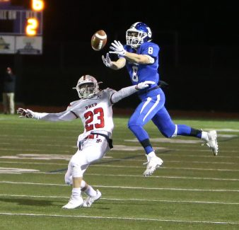 Southington High School's Jacob Flynn attempts to catch a pass over Fairfield Prep's Joseph Wuchiski during the Class LL football quarterfinal game in Southington on Tuesday. Emily J. Reynolds. Republican-American