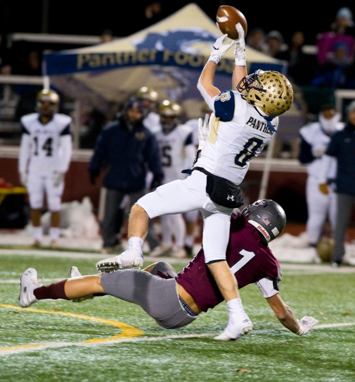Platt's Jake-L'Heureux Baker (8) nearly picks off a pass intended for Naugatuck's Isaiah Williams (1) after the two got tangles up during their Class L quarterfinal game Tuesday at Naugatuck High School. Jim Shannon Republican American