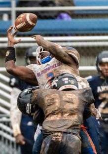 Ansonia's Jy'mere Jones #22 hits Bloomfield's Anthony Simpson #3 jarring the ball away from him for an incomplete pass during the Class S Semi-final game between Bloomfield and Ansonia at Ansonia High School in Ansonia on Sunday. Bloomfield held on to beat Ansonia 26-19 and advances to the Class S Championship game next week. Bill Shettle Republican-American