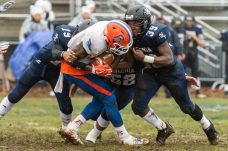 Ansonia's Troy Sanders #39 hits Bloomfield's Anthony Simpson #3 very hard with some help from teammate Chicago Rivers #19 during the Class S Semi-final game between Bloomfield and Ansonia at Ansonia High School in Ansonia on Sunday. Bloomfield held on to beat Ansonia 26-19 and advances to the Class S Championship game next week. Bill Shettle Republican-American