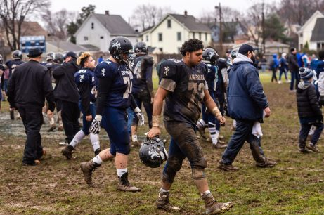 Ansonia's Nicholas DiPalma #73 walks off the field disappointed after getting beat by Bloomfield 26-19 during the Class S Semi-final game between Bloomfield and Ansonia at Ansonia High School in Ansonia on Sunday. Bill Shettle Republican-American