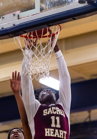 Sacred Heart forward Jamaal Waters #11 gets an put back for a dunk during the annual Waterbury Boys Basketball Jamboree at Kennedy High School in Waterbury on Sunday. Bill Shettle Republican-American