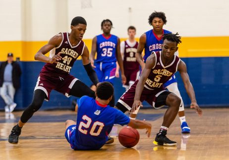 Sacred Heart players Omar Rowe #40 left, and Caleb Sampson #5 and Crosby's Rahmel Reid #20 all try to get to a loose ball during the annual Waterbury Boys Basketball Jamboree at Kennedy High School in Waterbury on Sunday. Bill Shettle Republican-American