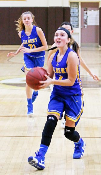 Gilbert's Tia Mongitore (2) eyes the hoop as she goes for a layup in a fastbreak against Thomaston Monday at Thomaston High School. Michael Kabelka / Republican-American