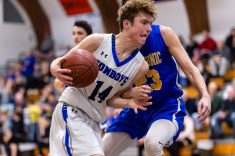 Litchfield's Zajans Crapo #14 drives to the basket against Housatonic's Cameron Ackerman #23 during a BL Boys basketball game between Housatonic Valley ad Litchfield at Litchfield High School in Litchfield on Thursday. Bill Shettle Republican-American
