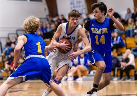 Litchfield's Tripp Melk #4 drives to the basket in between Housatonic defenders Caleb Shpur #1 and Michael Peirce #14 during a BL Boys basketball game between Housatonic Valley ad Litchfield at Litchfield High School in Litchfield on Thursday. Bill Shettle Republican-American