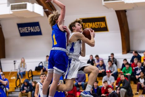 Litchfield's Zajans Crapo drives to the basket against Housatonic's Caleb Shpur #1 during a BL Boys basketball game between Housatonic Valley ad Litchfield at Litchfield High School in Litchfield on Thursday. Bill Shettle Republican-American