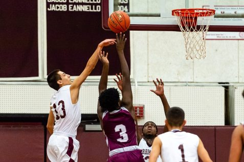 Torrington's CJ Root #13 blocks the shot of Naugatuck's Keywan Edwards-Garris #3 during a NVL Boys Basketball game between Naugatuck and Torrington at Torrington High School in Torrington on Thursday. Torrington held on to win in a close one 47-46 over Naugatuck. Bill Shettle Republican-American