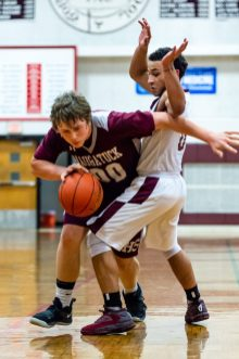 Naugatuck's Derrick Jagello #00 drives around Torrington's Dontae Thomas #0 during a NVL Boys Basketball game between Naugatuck and Torrington at Torrington High School in Torrington on Thursday. Torrington held on to win in a close one 47-46 over Naugatuck. Bill Shettle Republican-American