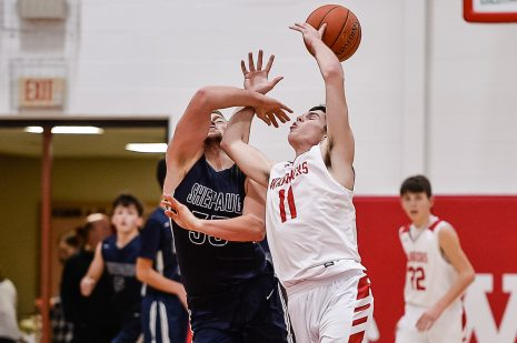 Shepaug's Ethan Hibbard #33, left, and Wamogo's Ethan Collins #11battle for a loose ball during a BL basketball game in the Litchfield Hills Holiday Claasic between Shepaug and Wamogo at Wamogo High School in Litchfield on Thursday. Bill Shettle Republican-American