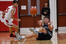 Shepaug's Cole Donaghey #4 hustles to a loose ball in front of Wamogo's Matt Mazzarelli #15 during a BL basketball game in the Litchfield Hills Holiday Claasic between Shepaug and Wamogo at Wamogo High School in Litchfield on Thursday. Bill Shettle Republican-American
