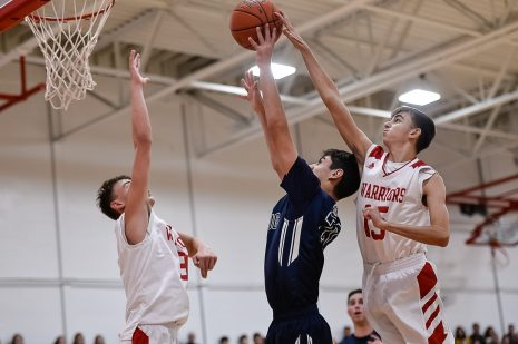 Wamogo's Matt Mazzarelli #15, right, attempts from behind to block the shot of Shepaug's Dominic Perachi #21, as Wamogo's Sean Coffey #3 defends in front during a BL basketball game in the Litchfield Hills Holiday Claasic between Shepaug and Wamogo at Wamogo High School in Litchfield on Thursday. Bill Shettle Republican-American