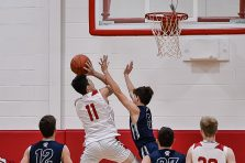 Wamogo's Ethan Collins #11 goes up for an easy basket against Shepaug's Owen Hibbard #5 during a BL basketball game in the Litchfield Hills Holiday Claasic between Shepaug and Wamogo at Wamogo High School in Litchfield on Thursday. Bill Shettle Republican-American